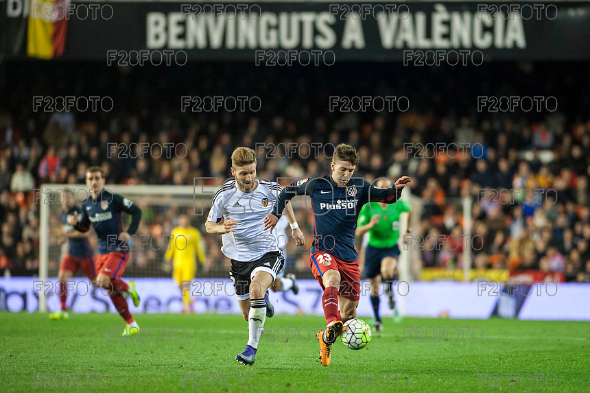 VALENCIA, SPAIN - MARCH 6: Vietto, Siqueira during BBVA League match between Valencia C.F. and Athletico de Madrid at Mestalla Stadium on March 6, 2015 in Valencia, Spain