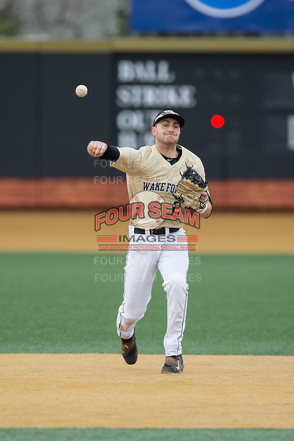 Wake Forest Demon Deacons shortstop Johnny Aiello (2) makes a throw to first base against the Harvard Crimson at David F. Couch Ballpark on March 5, 2016 in Winston-Salem, North Carolina.  The Crimson defeated the Demon Deacons 6-3.  (Brian Westerholt/Four Seam Images)