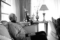 Former President Nelson Mandela of South Africa relaxes while on holiday on June 14, 2006 in Maputo, Mozambique. He is retired and takes time off with his wife Graca Machel in her residence in central Maputo. Mr. Mandela turns 88 on July 18, 2006. The ANC freedom fighter spent 27 years in prison, and was released in 1990. He became President of South Africa after the first multiracial democratic elections in April 1994. Mr. Mandela retired after one term in 1999 and gave the leadership to the current president Mr. Thabo Mbeki.