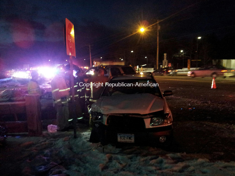 TORRINGTON, CT- 13 December 2013- 121313BJ02-- Firefighters at the scene of a two-vehicle crash on East Main Street after the last occupant was taken to to an ambulance. Three people were injured in the crash that happened at the entrance and exit lane near McDonald's. Bruno Matarazzo Jr. Republican-American