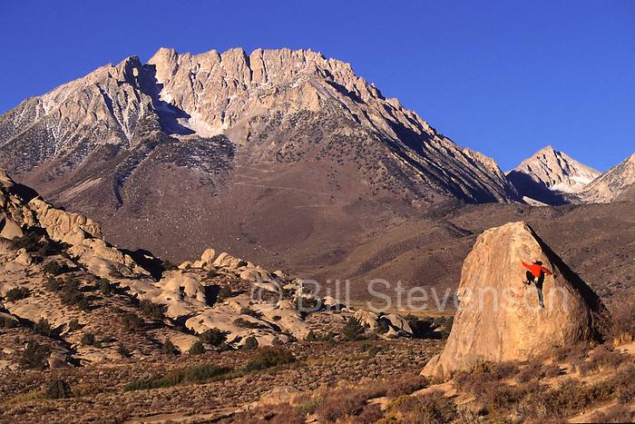 A man rock climbing at The Buttermilks, CA.