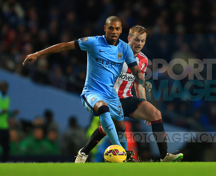 Sebastian Larsson of Sunderland chases Fernandinho of Manchester City - Manchester City vs. Sunderland - Barclay's Premier League - Etihad Stadium - Manchester - 28/12/2014 Pic Philip Oldham/Sportimage