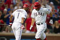 Texas Rangers second baseman Ian Kinsler #5 is congratulated by teammate Elvis Andrus #1 after his home run during the Major League Baseball game against the Baltimore Orioles on August 21st, 2012 at the Rangers Ballpark in Arlington, Texas. The Orioles defeated the Rangers 5-3. (Andrew Woolley/Four Seam Images).