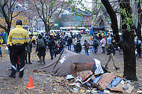 November 23, 2011, Police, protesters and media people watch as city workers dismantle and remove tents. Toronto Police arrived in significant numbers this morning, beginning the process of evicting the Occupy Toronto tent camp from St. James Park.