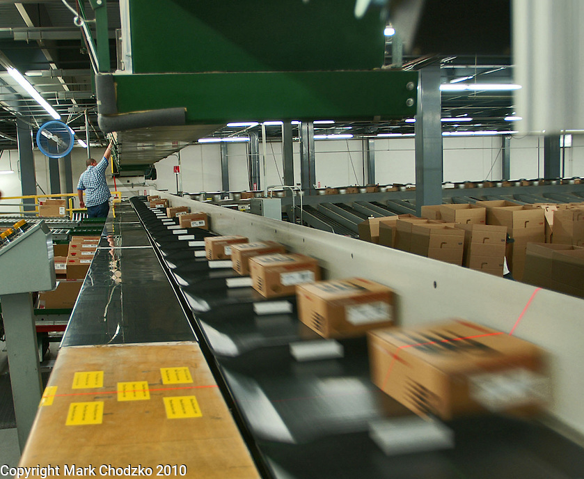 Freight is scanned and moves along conveyor belt.