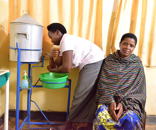 A community health workers giving a three-month birth control inoculation to a patient at Rhunda Health Center in eastern Rwanda.
