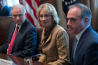 Secretary of Education Betsy DeVos (C), Attorney General Jeff Sessions (L) and Secretary of Veterans Affairs Secretary David Shulkin (R) listen to introductions during an opioid and drug abuse listening session in the Roosevelt Room of the White House in Washington, DC, USA, 29 March 2017. Photo Credit: Shawn Thew/CNP/AdMedia