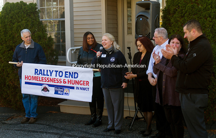 TORRINGTON, CT - 21 NOVEMBER 2015 -112115JW05.jpg -- Executive Director / CEO of FISH NWCT Deidre Houlihan DiCara thanks supporters in front of The Gathering Place during the start of a rally and Open House at both the Gathering Place and FISH NWCT Shelter and Pantry Saturday morning.  Jonathan Wilcox Republican-American