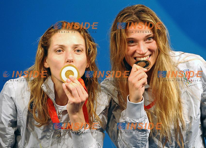 Maria Valentina Vezzali e Margherita Granbassi mordono e baciano le medaglie d'oro e di bronzo vinte nel fioretto.<br /> Fencing hall - Scherma<br /> Pechino - Beijing 11/8/2008 Olimpiadi 2008 Olympic Games<br /> Foto Andrea Staccioli Insidefoto
