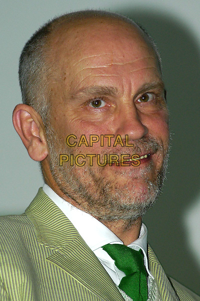 "JOHN MALKOVICH.""The Dancer Upstairs""  Gala screening, Bosnian National Theatre,10th Sarajevo Film Festival,.August 21st 2004..portrait headshot green suit tie.Ref: KRA.www.capitalpictures.com.sales@capitalpictures.com.©Capital Pictures."