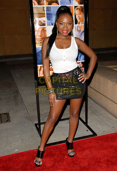 NATURI NAUGHTON.The Sony Picture Classics L.A. Premiere of 'Mother and Child' held at The Egyptian Theatre in Hollywood, California on .April 19th, 2010                 .full length white tank top silver grey gray mini skirt hand on hip.CAP/RKE/DVS.©DVS/RockinExposures/Capital Pictures.