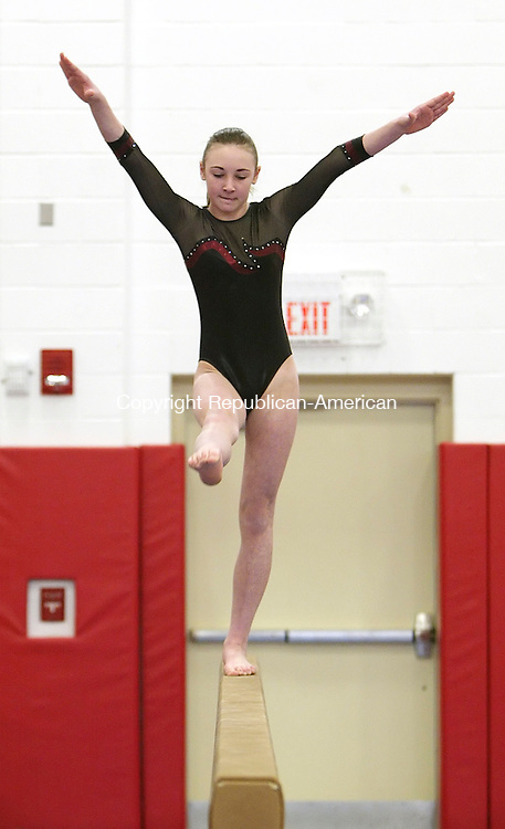 SOUTHBURY, CT, 01/10/08- 011009BZ04- Naugatuck's Ali Dube competes on the balance beam during an invite gymnastics meet at Pomperaug High School Saturday.<br />  Jamison C. Bazinet Republican-American
