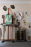 wooden easel and palettes
