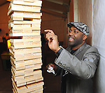 Chris Williams plays one of the many games at the Realcity Literacy party at 13 Celsius Thursday Feb. 18,2010. (Dave Rossman Photo)
