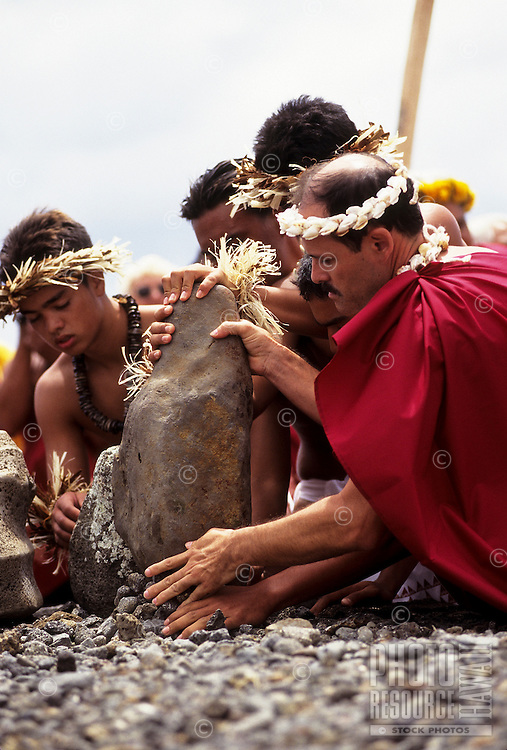 Holo Stender and students from Kamehameha Schools, Hawai'i, place pohaku (stones) from home on ahu (altar) at the celebration of Hokule'a arrival, Anakena, Rapa Nui, November 1999.