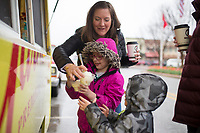 NWA Democrat-Gazette/CHARLIE KAIJO Patti Sosa of Kansas City, Mos. (center) gets ice cream with Lucy Sosa, 6 (center in pink) and Henry Sosa, 4, Thursday, March 29, 2018 at The Walmart Museum at Bentonville Square in Bentonville. <br />