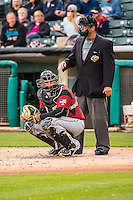 Guillermo Quiroz (6) of the Sacramento River Cats with home plate umpire Brian Reilly in action against the Salt Lake Bees in Pacific Coast League action at Smith's Ballpark on April 17, 2015 in Salt Lake City, Utah.  (Stephen Smith/Four Seam Images)
