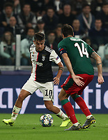 Football Soccer: UEFA Champions League -Group Stage-  Group D - Juventus vs Lokomotiv Moskva, Allianz Stadium. Turin, Italy, October 22, 2019.<br /> Juventus' Paulo Dybala (l) in action with Locomotiv Moskva's Vedran Corluka (r) during the Uefa Champions League football soccer match between Juventus and Lokomotiv Moskva at Allianz Stadium in Turin, on October 22, 2019.<br /> UPDATE IMAGES PRESS