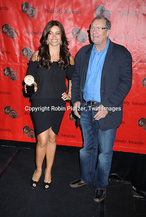 Sofia Vergara and Ed O'Neill posing for photographers at the 69th Annual Peabody Awards on May 17, 2010 at The Waldorf Astoria Hotel in New York City.