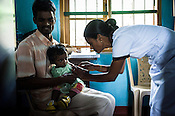 A man squirms while the nurse vaccinates his child at the local health clinic in Eskdale Tea Estate in Nuwareliya in Central Sri Lanka.  Photo: Sanjit Das/Panos