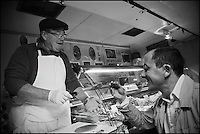 Europe/France/Bretagne/56/Morbihan/Lorient:  Philippe  Le Lay  du  Restaurant: Henri & Joseph goûte une terrine chez un charcutier du marché [Non destiné à un usage publicitaire - Not intended for an advertising use]