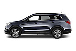 Car driver side profile view of a 2015 Hyundai Grand Santa Fe Executive 5 Door SUV