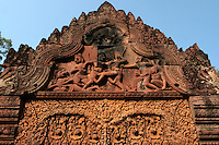 Banteay Srei or Banteay Srey is a 10th century Cambodian temple dedicated to the Hindu god Shiva.  The temple is mainly built  of red sandstone a material that lends itself to elaborate and decorative carvings which can still be seen today.