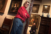 Martin Bijl (in red), 51, a restorer of paintings, and Ernst van de Wetering (in black), 67, from the Rembrandt Research Project, pose in the Rembrandt House Museum in Amsterdam, the Netherlands. ..Picture taken 21 September 2005 by Justin Jin.