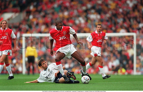 PATRICK VIEIRA on the ball challenged by STEVE CLEMENCE Arsenal 0 Tottenham 0, 970830. Photo:GLYN KIRK/Action Plus...1997.Soccer.tackle tackles tackling tackled.football.premiership premier league.club clubs