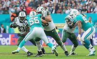04.10.2015. Wembley Stadium, London, England. NFL International Series. Miami Dolphins versus New York Jets. New York Jets Running Back Chris Ivory running with ball past Miami Dolphins Linebacker Koa Misi.