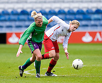 29 APR 2009 - LONDON,GBR - Gemma Wilson (right) - Leeds Met Carnegie (green and purple) v Northumbria University (white and red) - BUCS Womens Football Championships '09. (PHOTO (C) NIGEL FARROW)