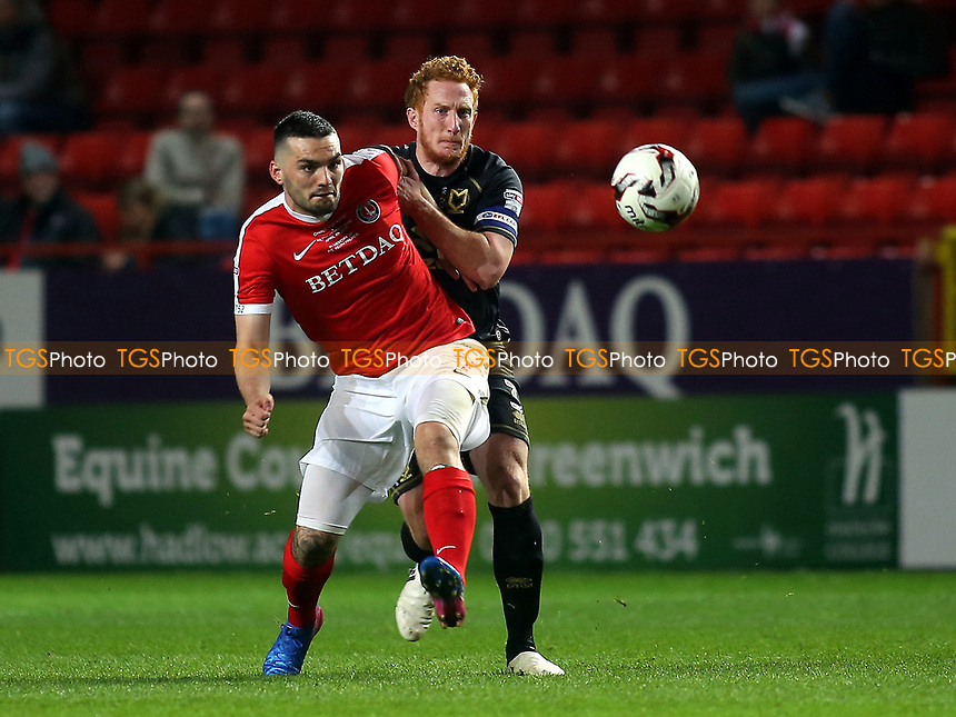 Tony Watt of Charlton and MK Dons Dean Lewington during Charlton Athletic vs MK Dons, Sky Bet EFL League 1 Football at The Valley on 4th April 2017