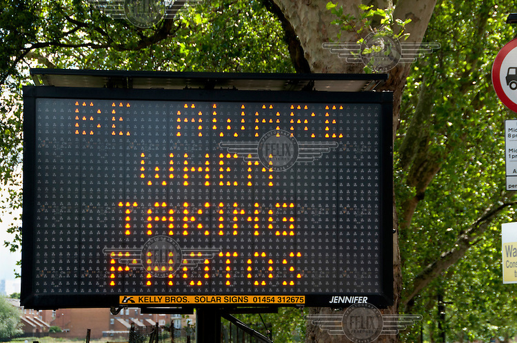 An electronic sign at entrance to the Hackney Radio One Music Festival warns: 'BE AWARE WHEN TAKING PHOTOS'.