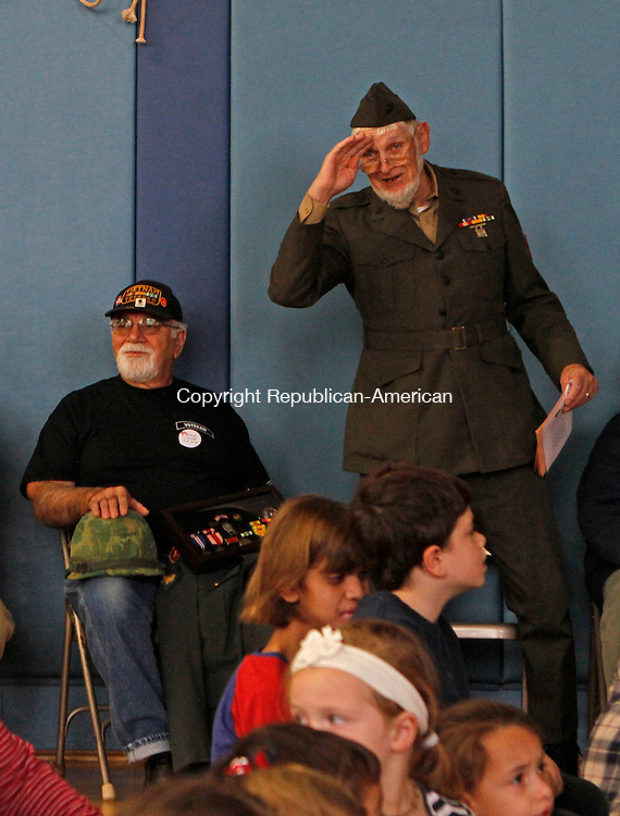 Southbury, CT-111116MK02 Vietnam U.S. Marine Crops veteran Andrew Stietzel salutes with the children just before the Veterans Day ceremony held at Pomperaug Elementary School on Friday Michael Kabelka / Republican-American.