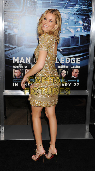 Elizabeth Banks.L.A. Premiere of 'Man on a Ledge' held at The Grauman's Chinese Theatre in Hollywood, California, USA..January 23rd, 2012.full length dress gold silver beads beaded sequins sequined   looking over shoulder.CAP/ROT/TM.©Tony Michaels/Roth Stock/Capital Pictures