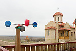 A child's wind toy spins in the wind at the Casian Monastery in Romania.