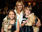 "From left: Kaia Mantor with Sake, Michelle Mantor and Stian Mantor with Friday at the ""Dog Days of Summer"" Yappy Hour benefitting Citizens for Animal Protection and Golden Beginnings Golden Retriever Rescue at Hotel Derek Wednesday July 21,2010.(Dave Rossman/For the Chronicle)"