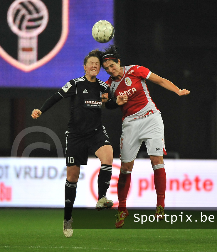 20131009 - LIEGE , BELGIUM : Standard's Cecile De Gernier (right)  pictured in a duel with Glasgow Suzanne Lappin (left) during the female soccer match between STANDARD Femina de Liege and  GLASGOW City LFC , in the 1/16 final ( round of 32 ) first leg in the UEFA Women's Champions League 2013 in stade maurice dufrasne - Sclessin in Liege. Wednesday 9 October 2013. PHOTO DAVID CATRY