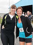 Bernadette Murphy and Lorraine McDonnell who took part in the Newtown Blues 12.5K run. Photo: Colin Bell/pressphotos.ie