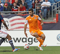Houston Dynamo forward Will Bruin (12) collects a pass.  In a Major League Soccer (MLS) match, the New England Revolution (blue/white) defeated Houston Dynamo (orange), 2-0, at Gillette Stadium on April 12, 2014.