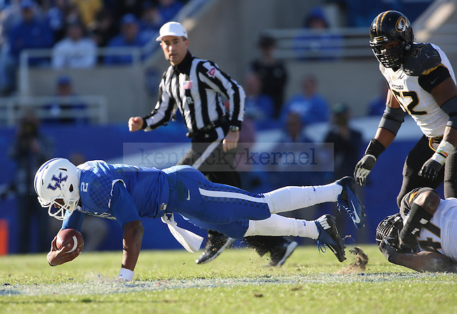 Kentucky Wildcats quarterback Jalen Whitlow (2) is sacked during the second half of the University of Kentucky vs. Missouri University football game at Commonwealth Stadium in Lexington, Ky., on Saturday, November 9, 2013. Mizzou won 48-17. Photo by Tessa Lighty | Staff