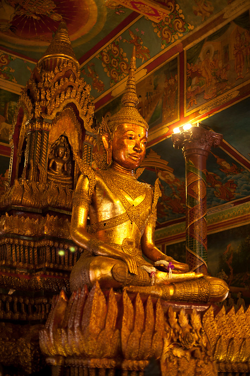 Famous golden Buddha at Wat Phnom temple Phnom Penh, Cambodia. <br /> <br /> Photos &copy; Dennis Drenner 2013.