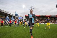 Match winner Jason McCarthy of Wycombe Wanderers enter the field during the Sky Bet League 2 match between Wycombe Wanderers and Oxford United at Adams Park, High Wycombe, England on 19 December 2015. Photo by Andy Rowland.