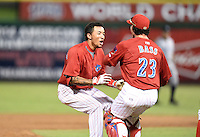 Clearwater Threshers shortstop J.P. Crawford (2) celebrates his game winning hit with Corey Bass (23) during a game against the Tampa Yankees on June 26, 2014 at Bright House Field in Clearwater, Florida.  Clearwater defeated Tampa 4-3.  (Mike Janes/Four Seam Images)