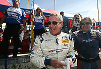 Sportscar racing legend Hurley Haywood celebrates his victory at the Grand Prix of Miami, Homestead-Miami Speedway, Homestead, FL, October 10, 2009. (Photo by Brian Cleary/www.bcpix.com).