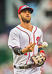 15 June 2016: Washington Nationals outfielder Bryce Harper tosses a ball to a fan while returning to the dugout between innings of a game against the Chicago Cubs at Nationals Park in Washington, DC. The Nationals defeated the Cubs 5-4 in 12 innings to take the rubber match of their 3-game series. Mandatory Credit: Ed Wolfstein Photo *** RAW (NEF) Image File Available ***