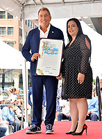 LOS ANGELES, CA. July 24, 2019: Kenny Ortega & Rana Ghadban  at the Hollywood Walk of Fame Star Ceremony honoring Kenny Ortega.<br /> Pictures: Paul Smith/Featureflash