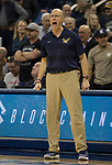 Akron head coach John Groce works the sidelines against Nevada in the second half of an NCAA college basketball game in Reno, Nev., Saturday, Dec. 22, 2018. (AP Photo/Tom R. Smedes)