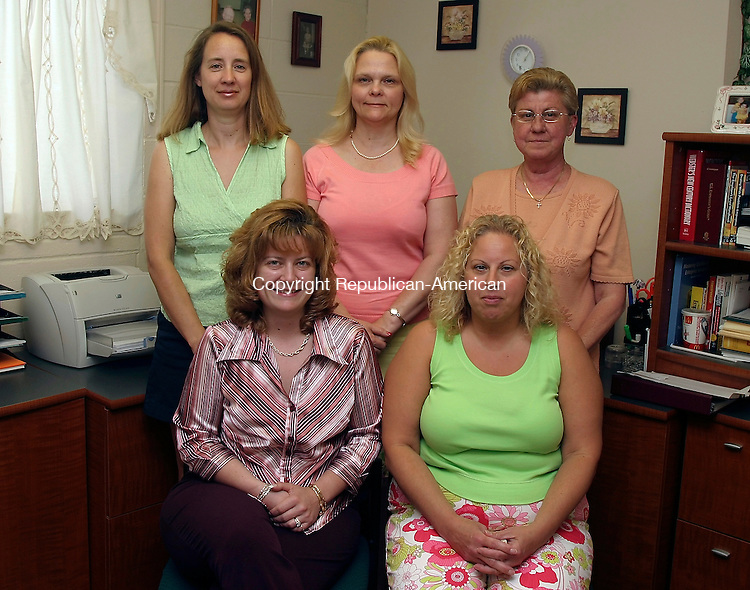 NAUGATUCK, CT- 26 JUNE 2005- 062605DA04.JPG - Where The Heart Is. Standing L-R (Billing) Kathy Aviles, (Vice President) Susan Griffin, (Office Assistant) Wanda Burke. Sitting L-R (Office Scheduling ) JoEllen Daniels, and (Office Assistant) Michelle Kalogrides. For Marketplace. Staff Photo. Darlene Douty