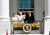 The pope, surrounded by Mrs Bush and the President,  bless the crowd from the Colonnades at the end of the Arrival Ceremony hosted by the president and Mrs Bush in the South Lawn of the  White House, Washington DC, April 16, 2008..